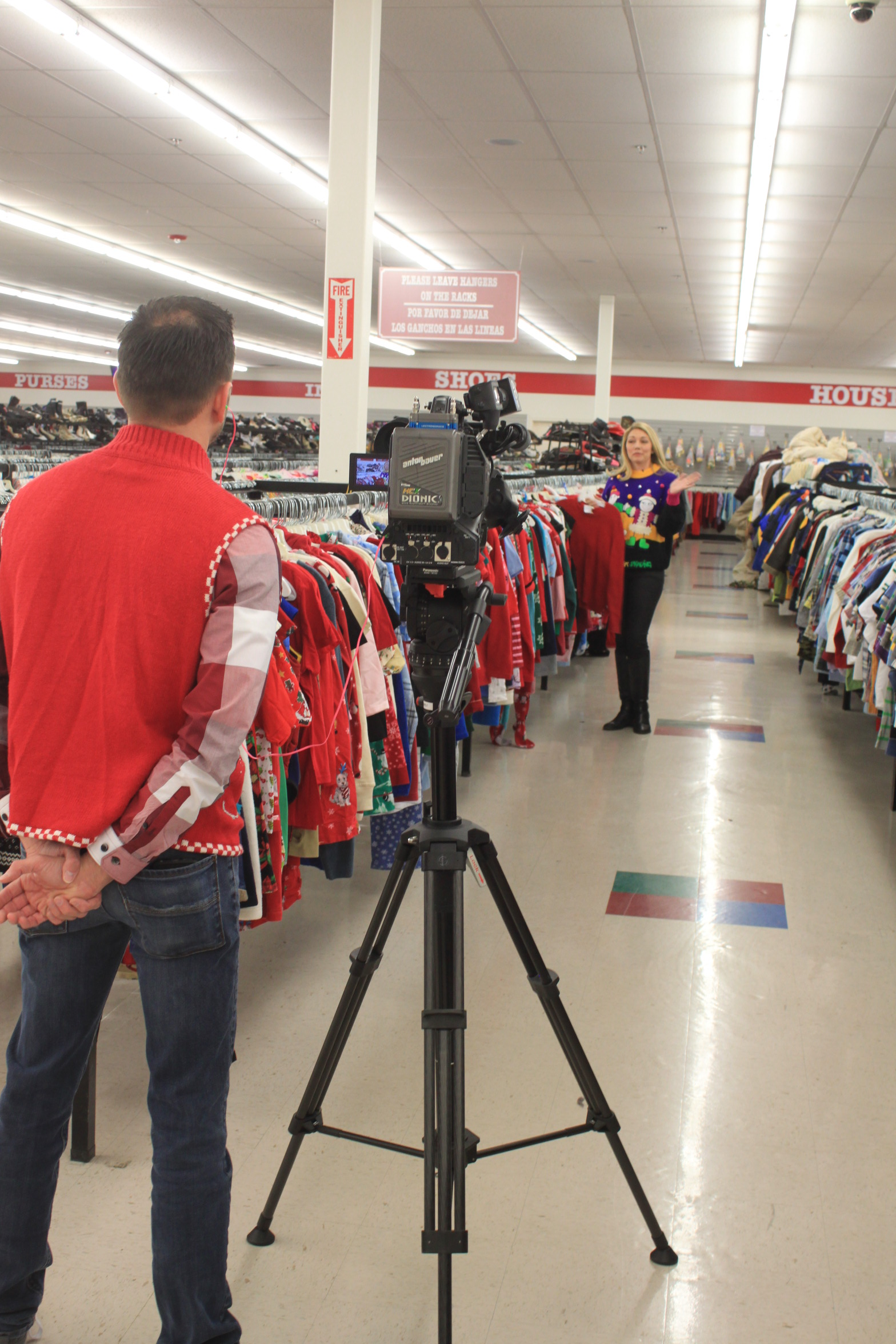 Filming Stretch Your Dollar, Ugly Christmas Sweater Segment at Houston Family Thrift Center Store